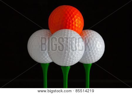 Golf Balls And Green Wooden Tees
