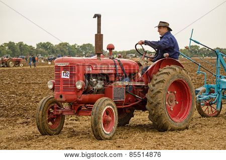 John Saunders driving vintage tractor
