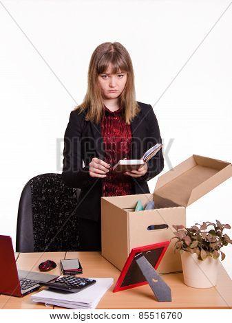 Dismissed Girl Puts Personal Belongings In Office