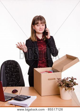 Girl In Office Collects Personal Belongings And Calling On Phone
