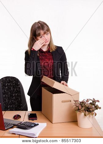 Dismissed Girl In Office Wipes Tears And Collects Things