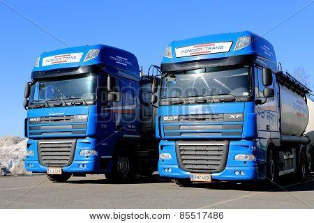 Two Blue DAF XF 105 Trucks