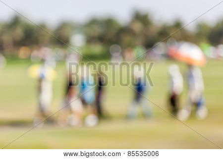 Blurred Photo Of Group Audience Moving On Green In Golf Tournament.