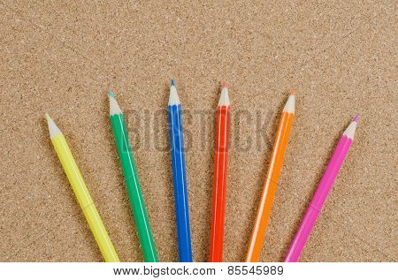 The colour pencils on �orkboard. School concept