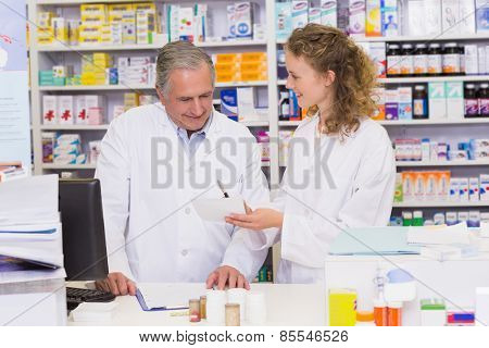 Team of pharmacists looking at prescription at hospital pharmacy