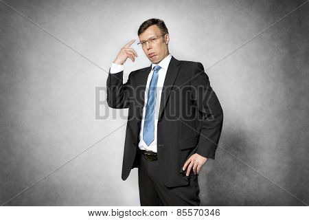 Conceited Business Man Pointing Finger To Head