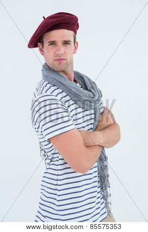French guy with beret looking at camera on white background