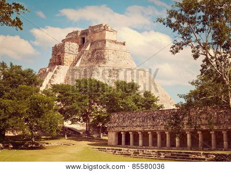 Vintage retro effect filtered hipster style image of anicent mayan pyramid (Pyramid of the Magician, Adivino  ) in Uxmal, M���©rida, Yucat���¡n, Mexico