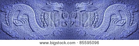 two Chinese blue dragons carved in the stone