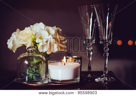 candles and champagne glasses