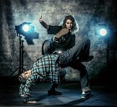 Two modern dancers over grunge background. Hip-hop. Urban, disco style. poster