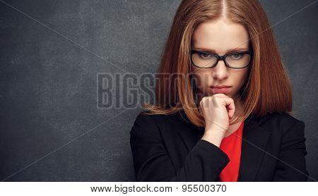 Serious Stern Woman Teacher At Blackboard