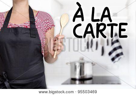 à La Carte Cook Wooden Spoon Holds Background