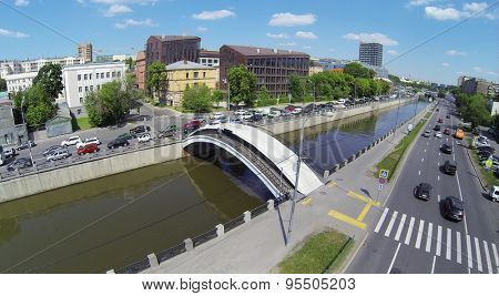 RUSSIA, MOSCOW - MAY 23, 2014: City traffic on quay of Yauza river near residential complex Art House at spring sunny day. Aerial view.