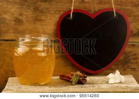Glass Jar Of Fresh Honey With Drizzler, Cinnamon On Wooden Background