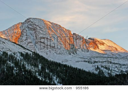 peak of the mountain in colorado. picture taken during the sunset. poster
