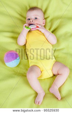 Cute boy holding teether
