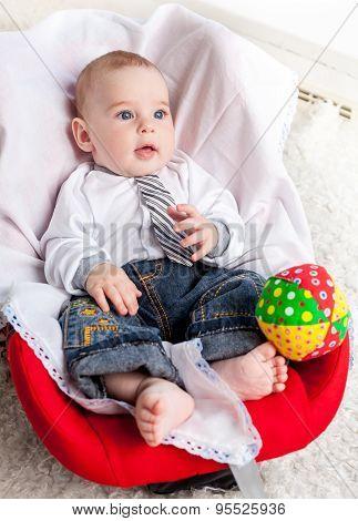 Baby boy sitting in car seat