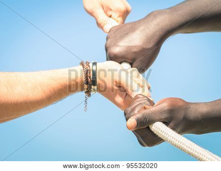 Tug Of War - Concept Of Interracial Multi Ethnic Union Together Against Racism - Multiracial Hands