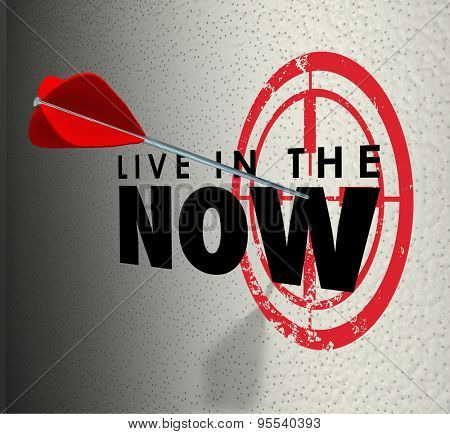 Live in the Now words on a target wall and arrow aiming and hitting the bulls-eye to illustrate enjoying and appreciating the present moment