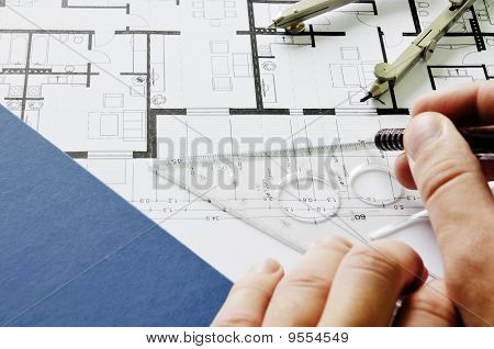 Architect drawing on blueprint