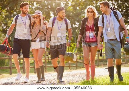 Group Of Young People Going Camping At Music Festival