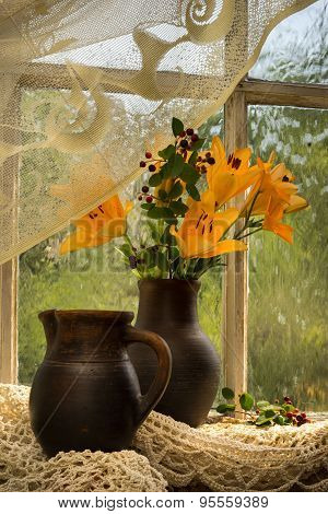 Orange Lily Bouquet On A Window Sill