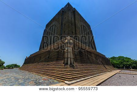 Monument to Afrikaner Leader at Voortrekker Monument. The Voortrekker Monument is located just south of Pretoria in South Africa. This massive granite structure is prominently located on a hilltop and was raised to commemorate the Voortrekkers who left th poster