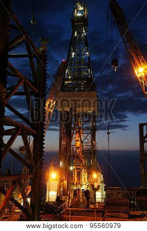 Derrick of Jack Up Drilling Rig (Oil Rig) at Twilight Time