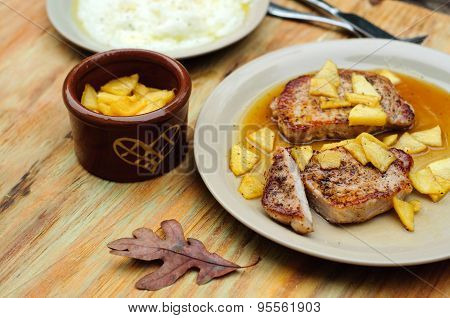 Pork chops with apple sauce and grits