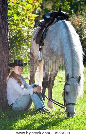 Young Lady in hat and the horse poster