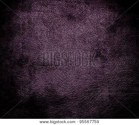Grunge background of dark byzantium leather texture