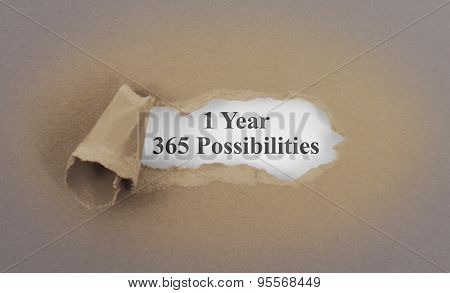 Text Appearing Behind Torn Brown Envelop