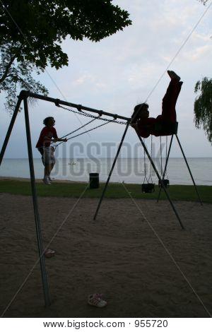 Sisters On The Swings