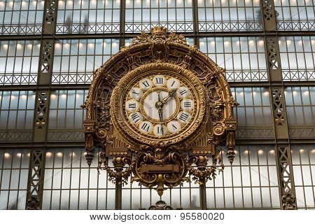 PARIS -SEPTEMBER 7 2014: Golden clock of the museum D'Orsay in Paris France. Musee d'Orsay has the largest collection of impressionist and post-impressionist paintings in the world.
