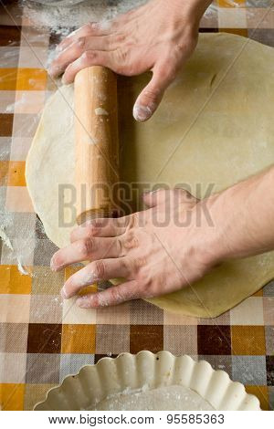 Cooking and home concept - close up of male hands kneading dough on a background in cell poster