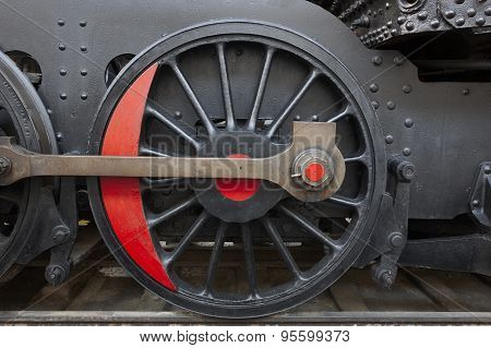 Steam Locomotive Wheel And Connecting Rod Detail. Black And Red