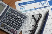 Credit report with score on a desk poster
