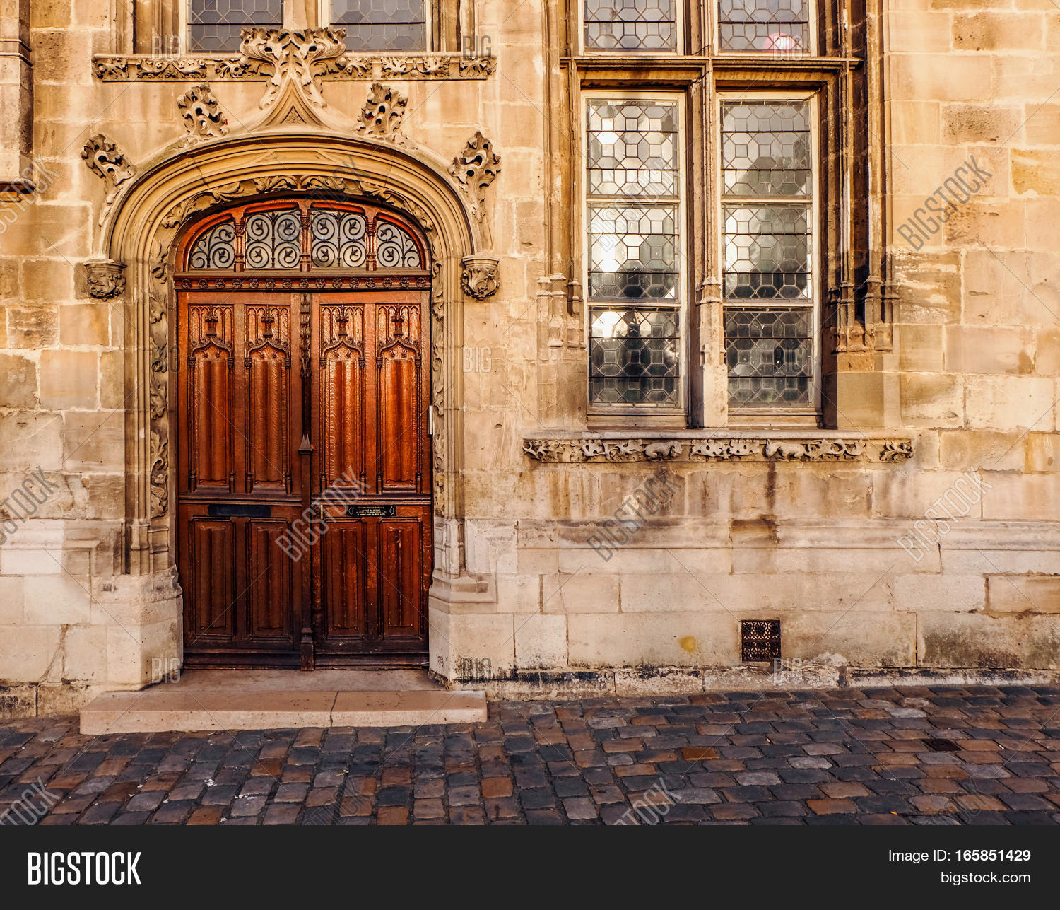 Wooden Double Door Entry Of An Old Church. The Door Frame Has A Rounded Arch