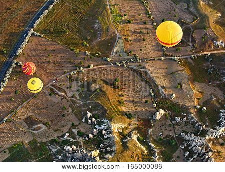 Balloon flight over ancient rocks and fields at Cappadocia is known around the world as one of the best places to fly with hot air balloons Goreme Cappadocia Turkey.