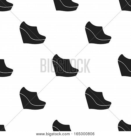 Wedge booties icon in  black style isolated on white background. Shoes pattern vector illustration.