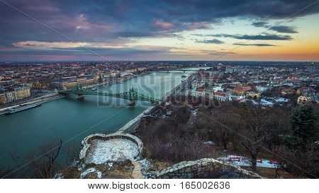 Budapest Hungary - Beautiful sunset over the city of Budapest with River Danube Szabadsag Bridge and Gellert Bath taken from Gellert Hill