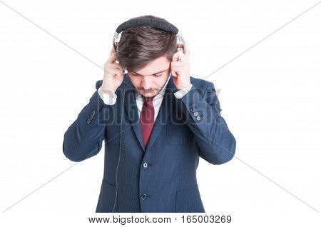 Business Man Standing Looking Down And Putting On Headphones