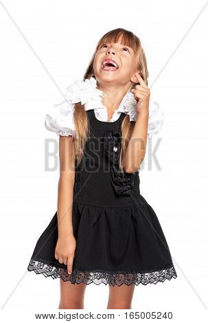 Portrait of little school girl looking and pointing finger up. Advertising and education concept - happy smiling child isolated on white background.