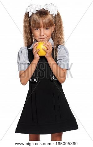 Portrait of beautiful little girl with yellow apple, isolated on white background. Healthy eating and food concept - happy cute child holding ripe fresh fruit.