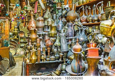 The old tea and coffe pots in antiquity stall located in city market of David's street Jerusalem Israel.