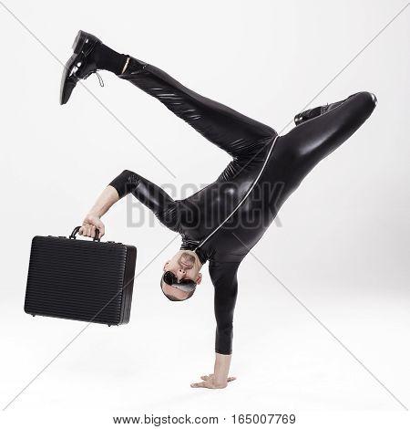 Futuristic breaker businessman with briefcase over white background