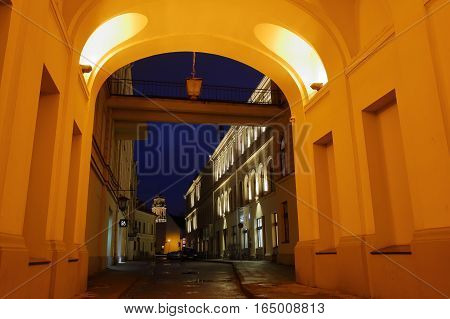 VILNIUS, LITHUANIA - JANUARY 2, 2017: An archway in the Old Town by night