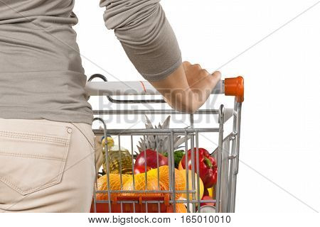 Closeup of a Woman Pushing a Shopping Cart Full of Groceries