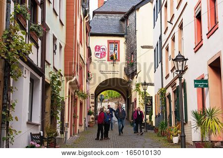 BERNKASTEL- KUES, RHINELAND-PALATINATE / GERMANY - OCTOBER 18, 2016:Tourists on the street of the medieval town on the  Moselle river